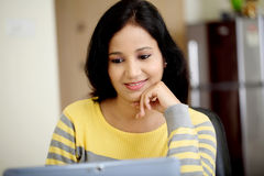 Young woman working with tablet computer Stock Photography