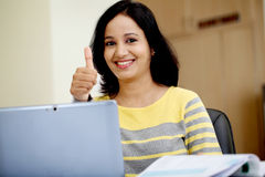 Young woman working with tablet computer Royalty Free Stock Image