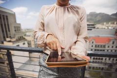 Young woman working on tablet PC Royalty Free Stock Photos
