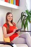 Woman working with tablet pc royalty free stock images