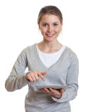 Young woman working with touch pad Royalty Free Stock Image