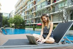 Young woman working uses new laptop pc outdoors remotely as free. Young female woman working with new laptop pc computer outdoors remotely as freelancer close to Stock Images