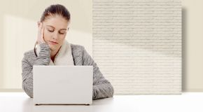Young woman working with a white laptop Stock Image