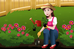 Young woman working in the yard Stock Photography