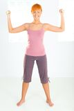 Young woman during workout Stock Photography