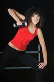 Young woman workout in fitness club with dumbbell Royalty Free Stock Photos