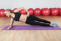 Young woman workout in the gym Stock Photography