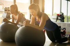 Young woman workout in healthy club. Royalty Free Stock Image