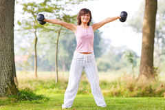 Young woman workout outdoors Stock Image
