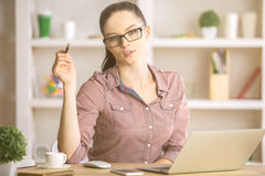 Young woman at workplace Stock Photos