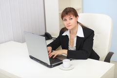 Young woman works with computer at office Royalty Free Stock Photo