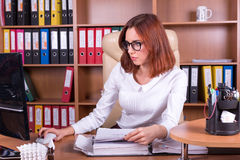 Young woman works with conputer in office Royalty Free Stock Photo