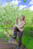 The young woman works in a garden Stock Image