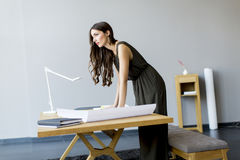 Young woman works on a project royalty free stock images