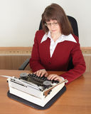 Young woman works with typewriter Stock Photography