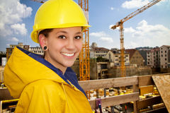 Young woman in workwear. Young woman on a building site in workwear royalty free stock image