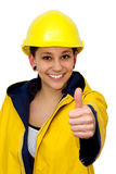 Young woman in workwear with thumb up Royalty Free Stock Photography