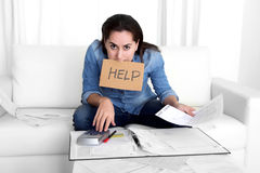 Young woman worried at home in stress accounting desperate in financial problems Stock Images