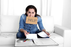 Young woman worried at home in stress accounting desperate in financial problems Royalty Free Stock Photo