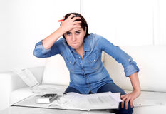 Young woman worried at home in stress accounting desperate in financial problems Royalty Free Stock Images
