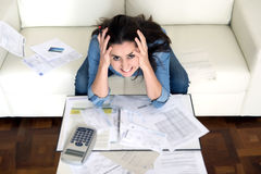 Young woman worried at home in stress accounting desperate in financial problems Stock Photos