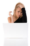 Young Woman Worried Using A Withe Laptop Royalty Free Stock Image