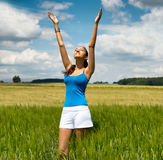 Young woman worshipping the hot summer sun Royalty Free Stock Image