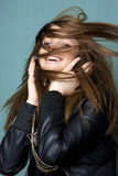 Young woman wrapped in hair dancing to the music Stock Photo