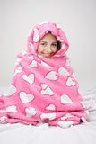 Young woman wrapped in pink blanket Royalty Free Stock Photography