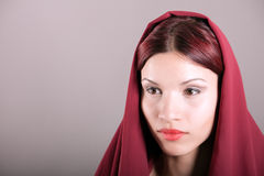 Young woman wrapped in scarf Royalty Free Stock Images