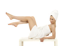 Young woman wrapped towel isolated on white background Royalty Free Stock Photo