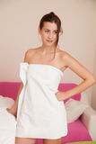 Young woman wrapped in a towel Royalty Free Stock Photos