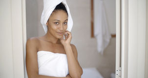 Young Woman Wrapped In Towels Stock Photo