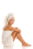 Young woman wrapped towels Royalty Free Stock Photography