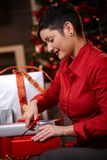 Young woman wrapping christmas gifts Royalty Free Stock Photo