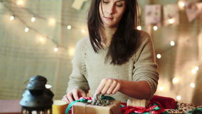 Young Woman Wrapping Christmas Gifts At Home. Young Woman Wrapping Christmas Gifts With Brown Paper At Home stock footage