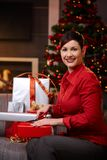 Young woman wrapping gifts at christmas Royalty Free Stock Photos