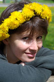 Young woman with a wreath. Young woman with a crown of dandelions to head Royalty Free Stock Photos