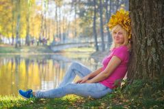 Young woman with the wreath of autumn leaves Royalty Free Stock Photos