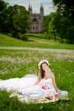Young woman in a wreath of flowers like princess Royalty Free Stock Photo