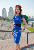 A young woman in a wreath in front of the cityscape. Royalty Free Stock Photography