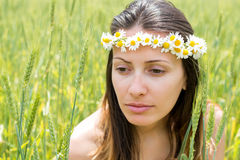 Young woman with a wreath on her head Stock Photography