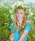 Young woman in a wreath from wild flowers Royalty Free Stock Photo