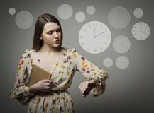 Young woman and wristwatch. 2 p.m. Stock Photography