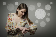 Young woman and wristwatch. 12 p.m. Stock Image