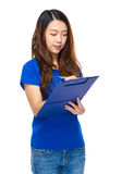 Young woman write on clipboard Royalty Free Stock Images