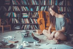 Young woman writer in library at home creative occupation no inspiration stock images