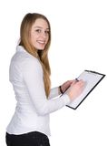 Young woman writes at a clipboard Royalty Free Stock Image