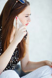 Young woman writes an SMS to your mobile phone Royalty Free Stock Images