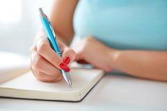 Young woman writes to black diary Royalty Free Stock Photo